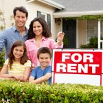 family with home for rent sign