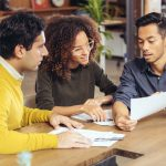 Couple on meeting with real estate advisor